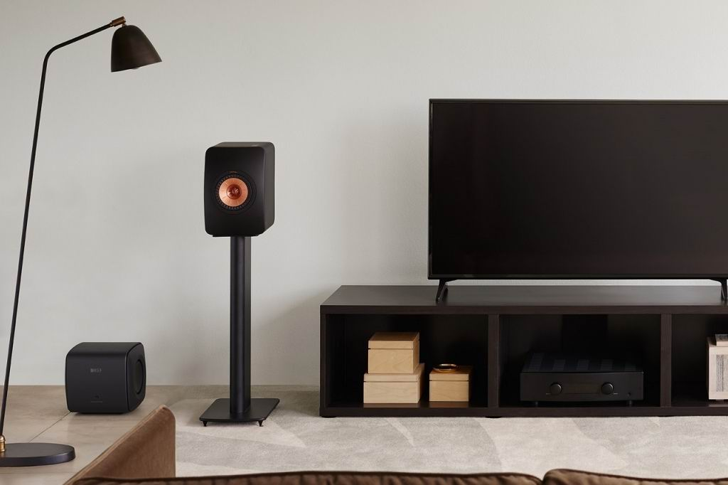 kef_lifestyle_ls50meta_carbonblack_withs2floorstand_kc62_entertainment__large_full.jpg